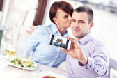 Kiss in a restaurant — Stock Photo
