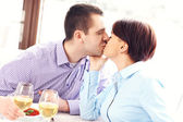 Kissing couple in a restaurant — Foto Stock
