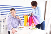 Woman showing her new purchase to husband — Stock Photo