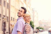 Happy tourists in the old Town — Stock Photo