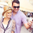 Young couple taking picture of themselves while sightseeing the — Stock Photo