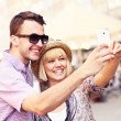 Happy couple taking a picture of themselves while sightseeing — Stock Photo