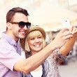Happy couple taking a picture of themselves while sightseeing — Stock Photo #47341349