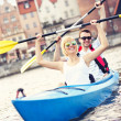 Tourists canoeing around the city — Stock Photo #47341359