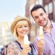 Young couple eating ice-cream — Stock Photo
