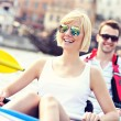 Young couple relaxing in a canoe — Stock Photo #47341367