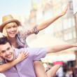 Young crazy couple having fun in the city — Stock Photo