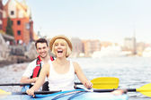 Happy tourists in a canoe — Foto Stock