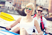 Young couple relaxing in a canoe — Foto Stock