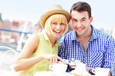 Happy tourists checking their camera — Stock Photo
