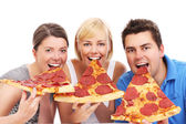 Friends eating huge pizza slices — Stock Photo