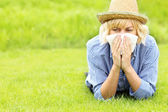 Woman allergic to grass — Stock Photo