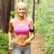 Woman jogging in the forest — Stock Photo #48099795