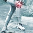 Jogger with hurt knee — Stock Photo #48099871