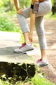Jogger having problems with ankle — 图库照片