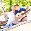 Happy couple on the beach with guitar — Stock Photo #50333241
