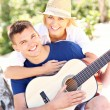 Happy couple and guitar — Stock Photo #50333329