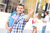 Handsome student showing ok sign in the campus — Stock Photo