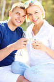 Happy couple and champagne — Stock Photo