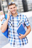 Handsome student talking on the phone — Stock Photo