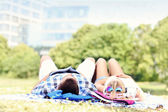 Young couple resting in the park — Stock Photo