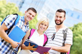 Group of happy students learning in the park — Stock Photo