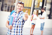 Handsome student showing ok sign in the campus — Foto Stock