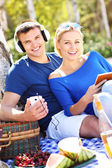 Young couple relaxing at the beach — Stock Photo