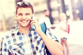 Happy student talking on the phone — Foto Stock