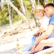 Romantic couple playing guitar at the beach — Stock Photo #50423383