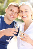 Romantic couple with champagne — Stock Photo