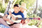 Joyful couple and guitar — Stock Photo