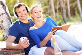 Happy couple relaxing at the beach — Stock Photo