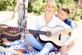 Adult couple and guitar — Stock fotografie