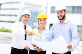 Group of architects on site — Stock Photo