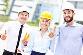 Group of happy architects on site — Stock Photo