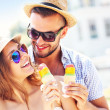 Lovely couple eating ice-cream in the city — Stock Photo