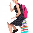 Schoolgirl sitting on a stack of books — Stock Photo #51589183