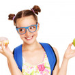 Schoolgirl with healthy and unhealthy lunch choices — Stock Photo #51589201
