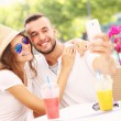 Happy couple taking selfie in a cafe — Stock Photo #51589317