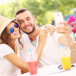 Happy couple taking selfie in a cafe — Stock Photo