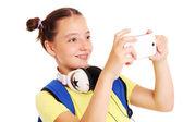 Schoolgirl taking pictures with her smartphone — Stockfoto