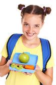 Schoolgirl with healthy lunchbox — Stock Photo