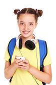 Schoolgirl and smartphone — Stock Photo