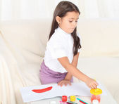 Little girl holding a brush and starting drawing — Stock Photo