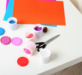 Pains, paintbrush, scissorson table — Stock Photo