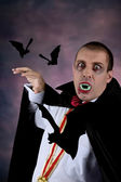 Portrait of a man with Count Dracula style make-up. Shot in a studio. — Stock Photo