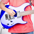 Plays on the electric guitar — Stock Photo