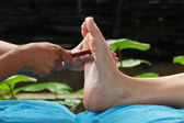 Foot massage by wood stick for Thyroid gland — Stock Photo