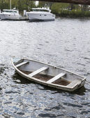 Small sinking boat with water inside — Stock Photo